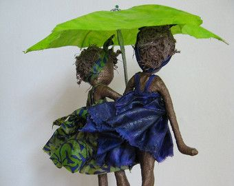 Rainy Days. Sculpture of Children with umbrella. Friendship sculpture. Available