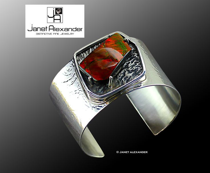 """1 1/2"""" wide roller printed sterling silver bracelet cuff with Ammonite opal on reticulated sterling silver."""