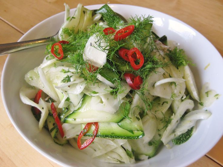 Courgette and fennel salad  topped with fennel fronds and red chilli http://theproofofthepudding.net/2014/07/20/fennel-and-courgette-salad/