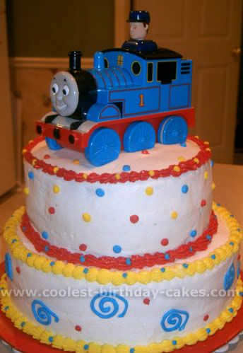thomas the train cakes - Could just make two small cakes stacked and add colorful dots and put a plastic train on top...cheap way to do it