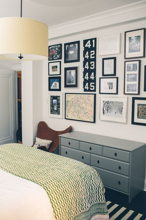 The couple in this DC home have a tradition of hanging pictures and mementos from their travels on the wall opposite the bed so they go to bed every night and wake up every morning reminded of all the places they've been together.