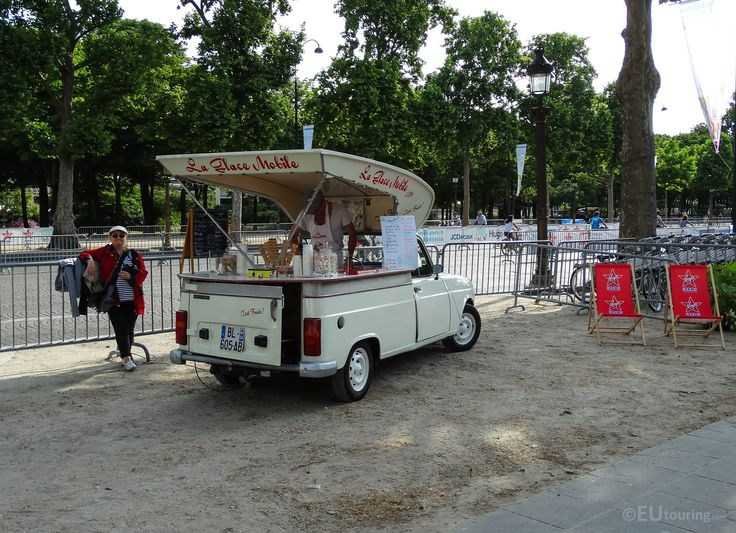 Spotted on the Champs Elysees is this classic ice-cream car, offering a variety of cool treats while in Paris.  You may be interested in more; www.eutouring.com/images_paris_city_life.html