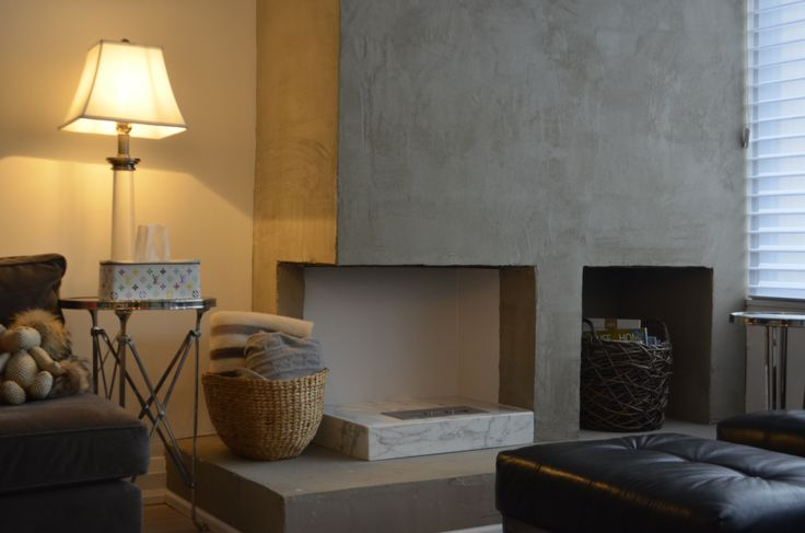 Here's a modern fireplace that will help you keep cozy and warm this winter.