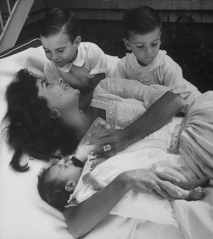 Cuddling with her sons, Michael and Christopher Wilding, and her baby daughter, Liza, on March 1, 1967.