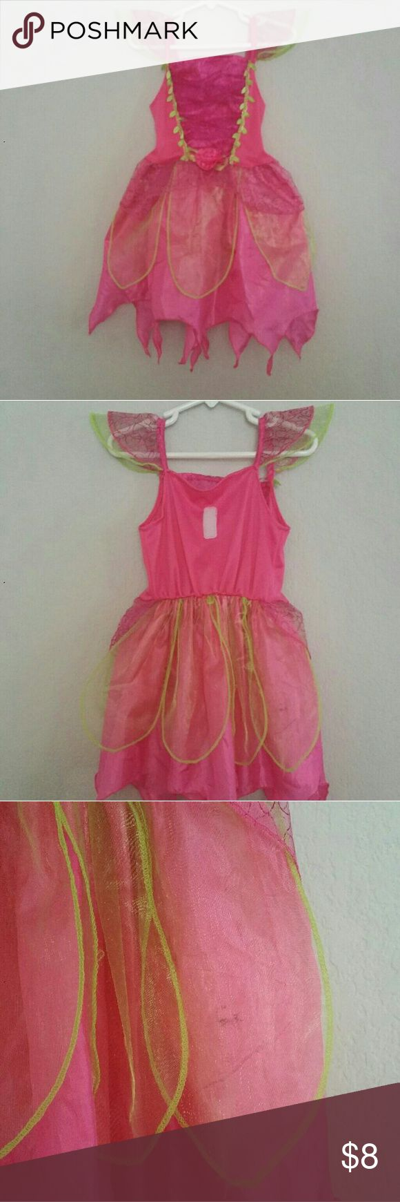 Pretty pink fairy princess Great pre loved condition. Has velcro on the back to attach wings. There is a small black mark on the back of the skirt. It's under the petal material and honestly I just noticed it while taking photos. Costumes