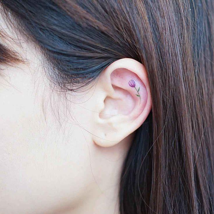 little tiny tulip tattoo on ear