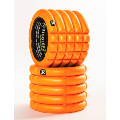 """The GRID Mini is the newest addition to the line up of unique foam rollers from Trigger Point. It is designed with the same 3D density matrix as the Original Grid, but its mini dimensions (5"""" x 5.5"""") make it perfect for travel.  THis little mini comes is several colors (orange, black, camo, PINK) and it's become a favorite of many celeb trainers and athletes.  It's also great for simply rolling out the stresses/tensions of everyday – sitting at a desk, carrying kids, running errands, etc"""