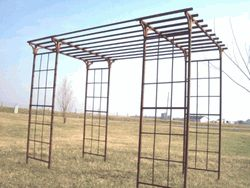 This wrought iron pergola or gazebo is the largest one we offer using 2 mission arbors. We connect them with 14 steel rods and you can push these rods
