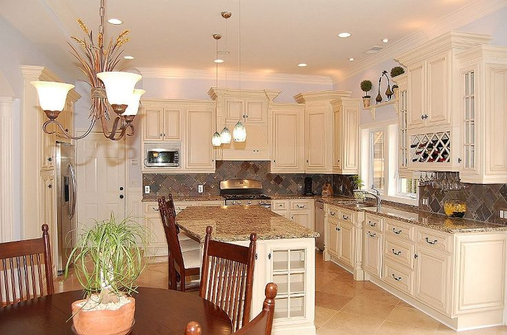 25 best ideas about cream colored kitchens on pinterest for Butter cream colored kitchen cabinets