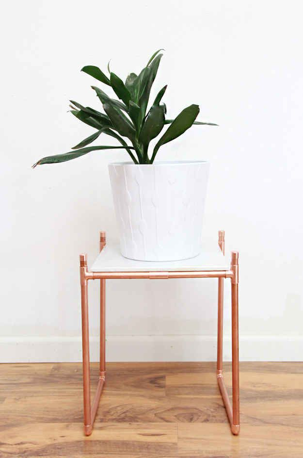 Balance a marble tile on a copper pipe frame for a pretty plant stand.