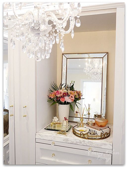 DIY Custom Closet Dressing Room   Crystal chandelier, view of built-in vanity   Vanity marble counter top styling Hermes perfume jewelry tray   Classy Glam Living
