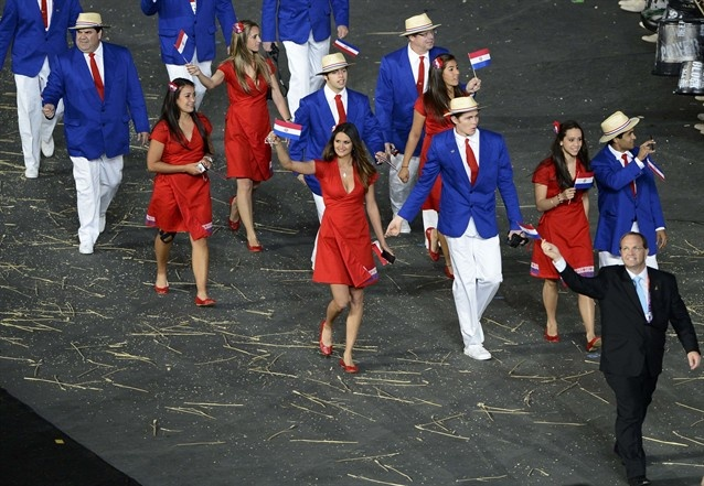 Another Olympic fashion favorite: Team Paraguay makes a stunning entrance with bold, red, A-line wrap dresses with just enough sexy cleavage to spice things up!