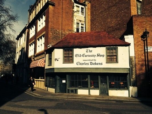 The Old Curiosity Shop | Atlas Obscura: Dating from the 16th century, its sloping roof, overhanging second floor, and uneven Tudor gabling mark it as one of London's oldest shops.