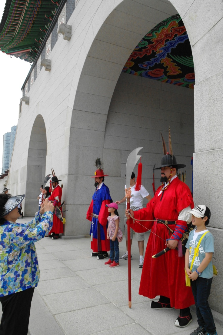 Guards of the palace.  traditional clothes.  tourists' attraction.