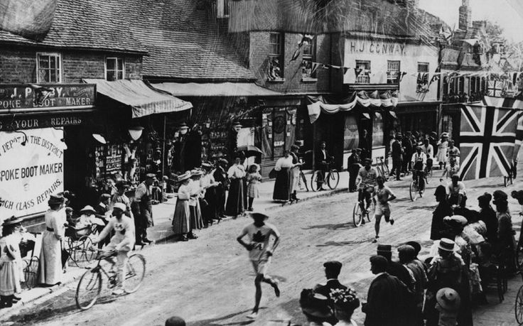 Marathon competitors dash past shops and crowds on the route between Windsor Castle and White City Stadium.1908 olympics