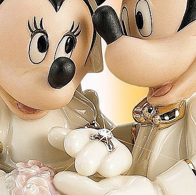 Lenox Disney's Showcase Minnie's Dream Wedding. Mickey & Minnie are on top of the world... or at least your wedding cake! Two all-time favorite sweethearts form this sculpted figurine. Crafted of hand-painted ivory china with 24 karat gold and pearlescent accents. Minnie's veil is dusted 24 karat gold. Her ring bears an aurora borealis Austrian crystal gem.