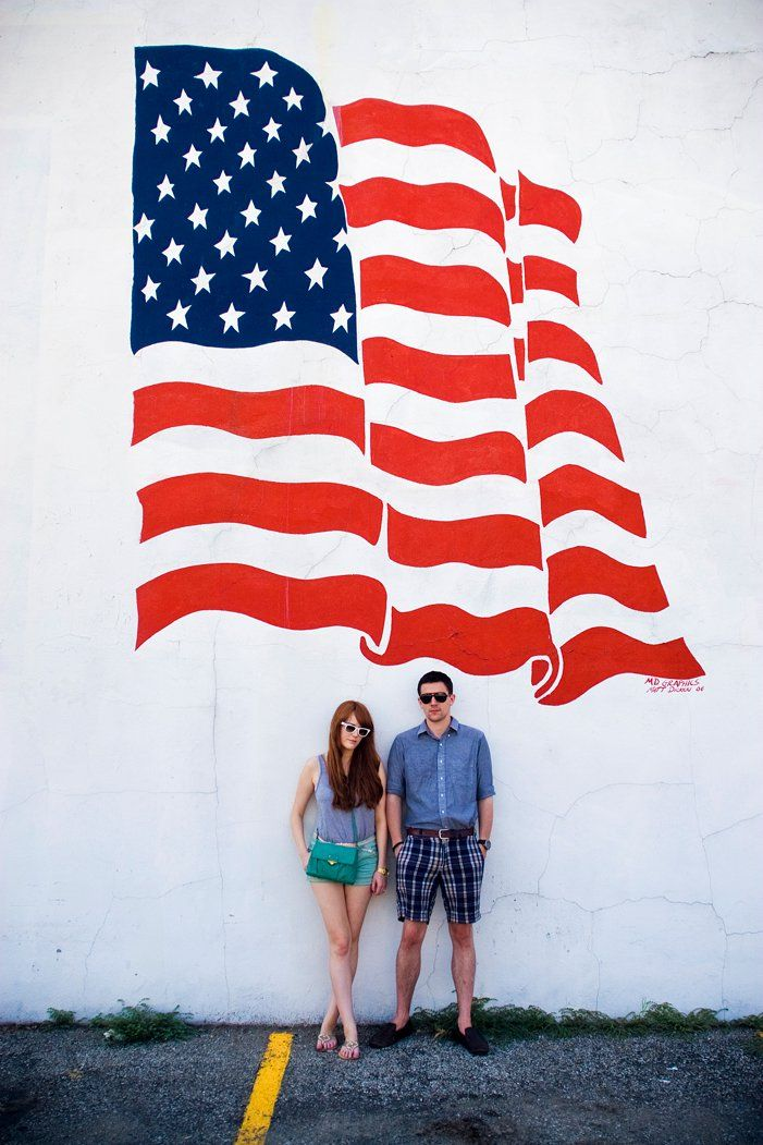 us + a huge flag painting.