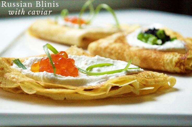Blinis are thin Russian pancakes served with sweet or savory sauces. A symbol of the sun, they are eaten en masse during the Russian holiday Maslenitsa.