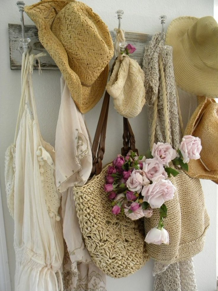 I have vintage hooks like this in my room to hang the same type of things...straw hats & straw purses, etc. is such a pretty way to be artful & functional! Love it!