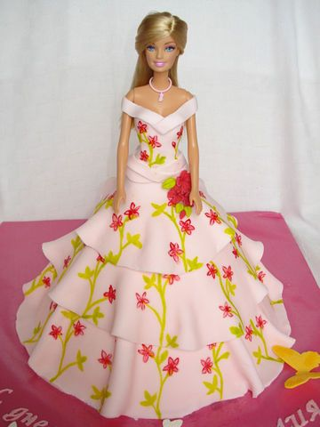 a barbie cake made with a real barbie doll and covered with fondant