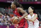 USA's Tamika Catchings drives past Czech Republic's Katerina Zohnova during a women's basketball game at the 2012 Summer Olympics, Friday, Aug. 3, 2012, in London. (AP Photo/Charles Krupa)