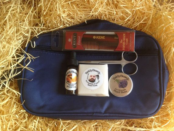 This is the BaldyBeardy Beard Trimming and Grooming Kit. It comprises: 1 x Beard Conditioning Oil (10ml bottle), 1 x Beard Balm OR Moustache Wax (15ml tin), 1 x Beard Soap (50g bar) OR Beard Shampoo (50ml bottle), 1 x Beard and Moustache Trimming Scissors, 1 x Kent Beard Comb, 1 x Travel Carrier Bag. This package is perfect for the beardsman who wants to look his best at all times even when on the move and would make a perfect gift.