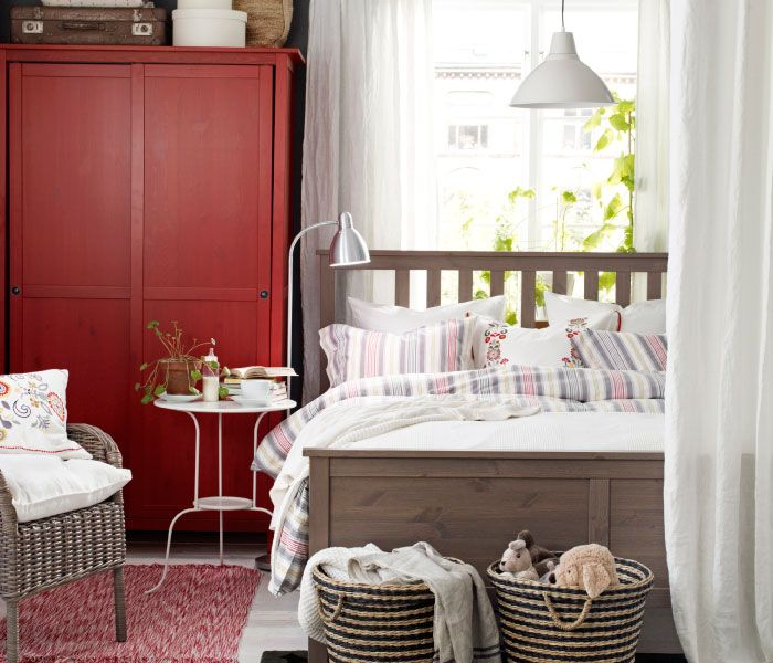 Traditional style bedroom (loving the red) and the two baskets can be used for dirty clothes (him) and me