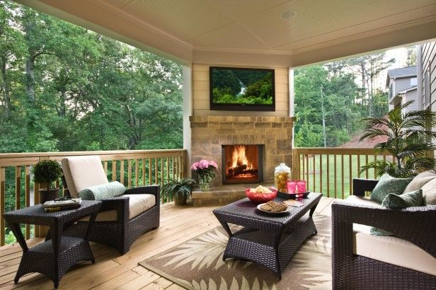 Model Example The view may be pretty, but don't forget about the entertainment and seating. Make plans early in the design of your outdoor fireplace spot to add a TV over the mantle, if you or other homeowners want to watch sports, movies or even cartoons outdoors