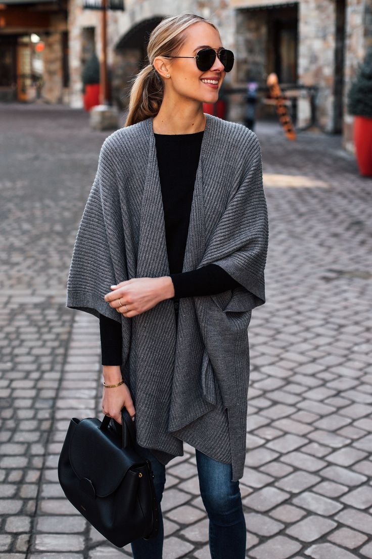Blonde Woman Wearing Grey Sweater Poncho Black Top…