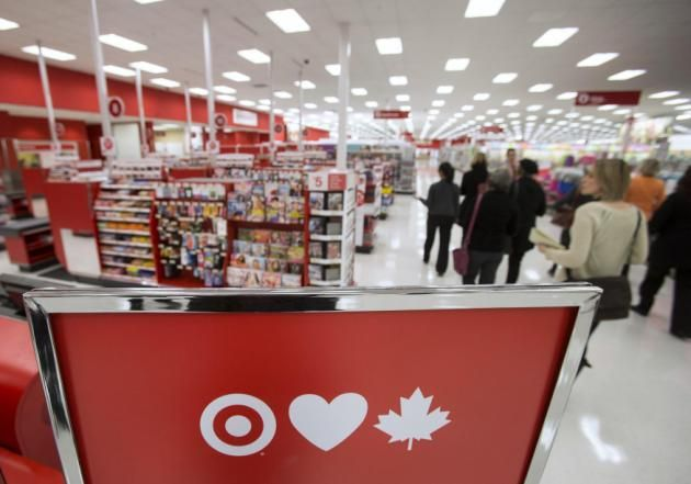 Goodbye to an EPIC Brand-Members of the media tour Target Canada's pilot store in Guelph, Ontario in this March 4, 2013 file photo. Target Corp said on January 15, 2015 it has sought creditor protection in Canada and that it plans to discontinue operating stores in Canada through its indirect wholly-owned subsidiary, Target Canada Co. REUTERS/Geoff Robins/Files (CANADA - Tags: BUSINESS MEDIA)