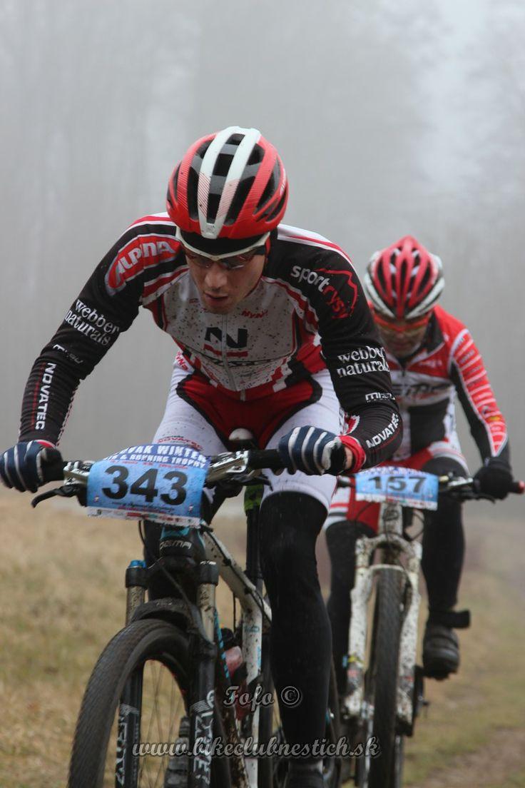 Mountain bike MTB racer on fog biely kriz Slovak Winter MTB & Running Trophy