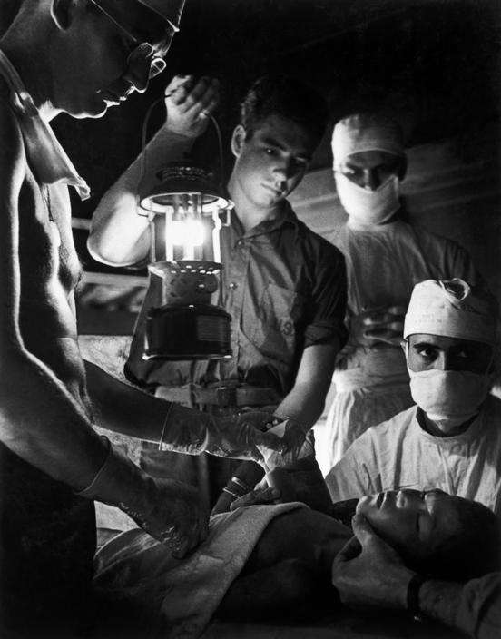 W. Eugene  Smith The Pacific Campaign. November 1944. Leyte, Philippines. A hospital for wounded US soldiers installed in the Leyte cathedral. (rw)