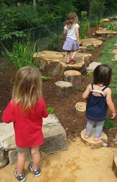 Love natural playscapes for children. This idea of stumps as stepping stones would be great for any preschool outdoor play area or for your own home. Boulders, stumps, faux dried creek beds, plant shelters...