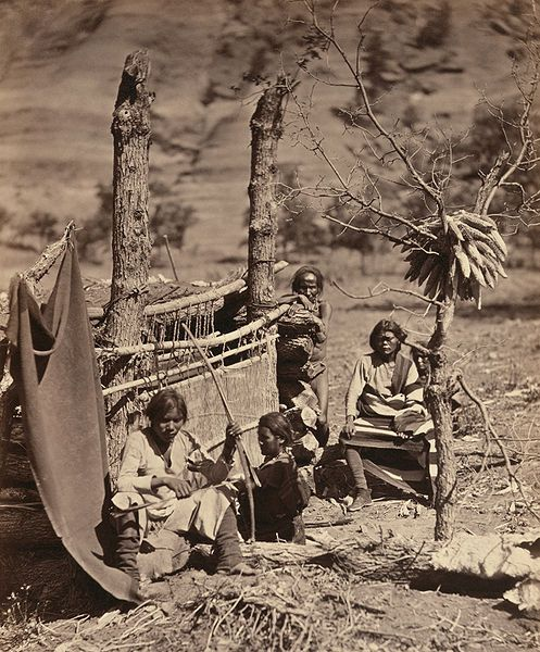 Navajo family with loom. Near Old Fort Defiance, New Mexico. Albumen print photograph, 1873.
