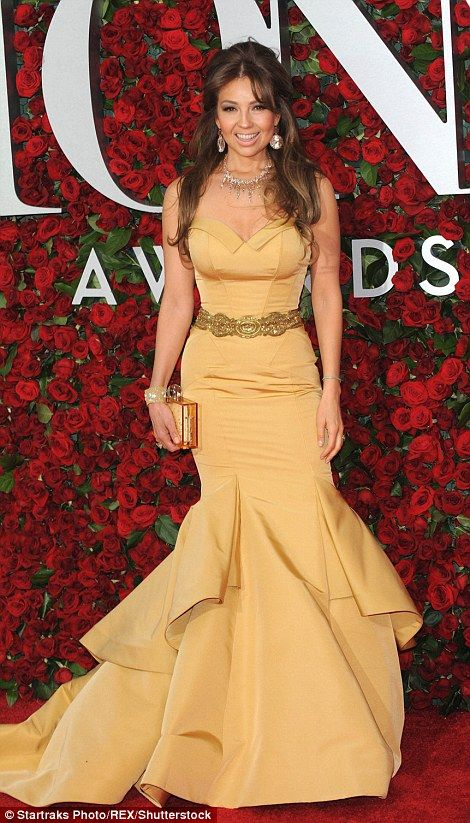 On the same page: Singer Thalia and actress Megan Hilty both accentuated their curves in s...