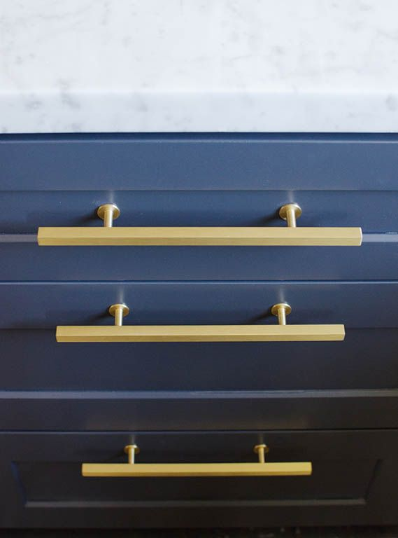 Seriously gorgeous navy blue and brass detailing in this kitchen #kitchendesign #interiors