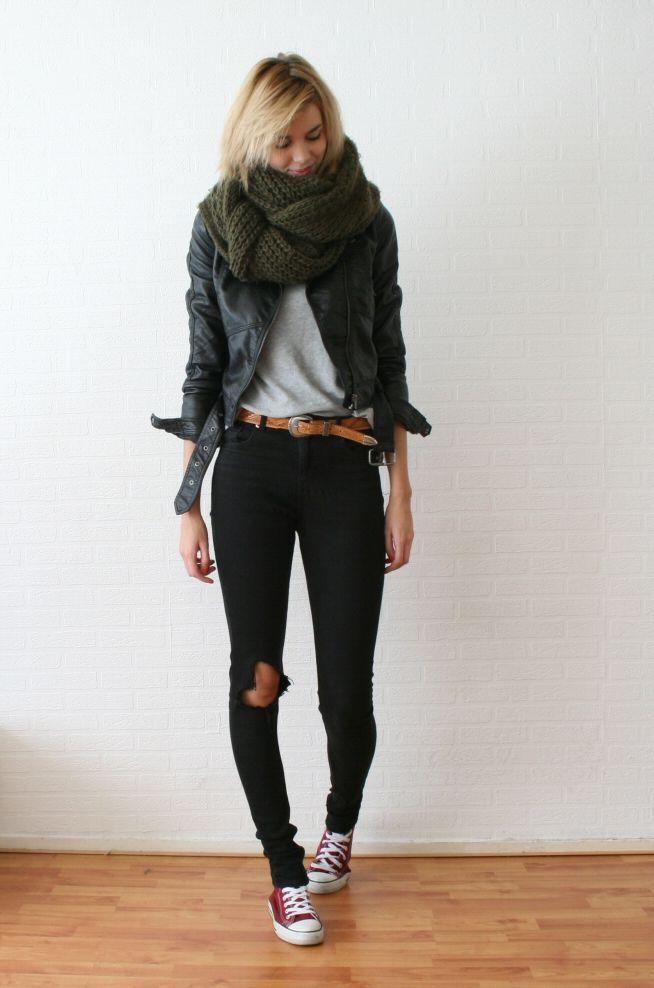 Black jeans, brown belt, grey sweater/tshirt, black jacket & green scarf