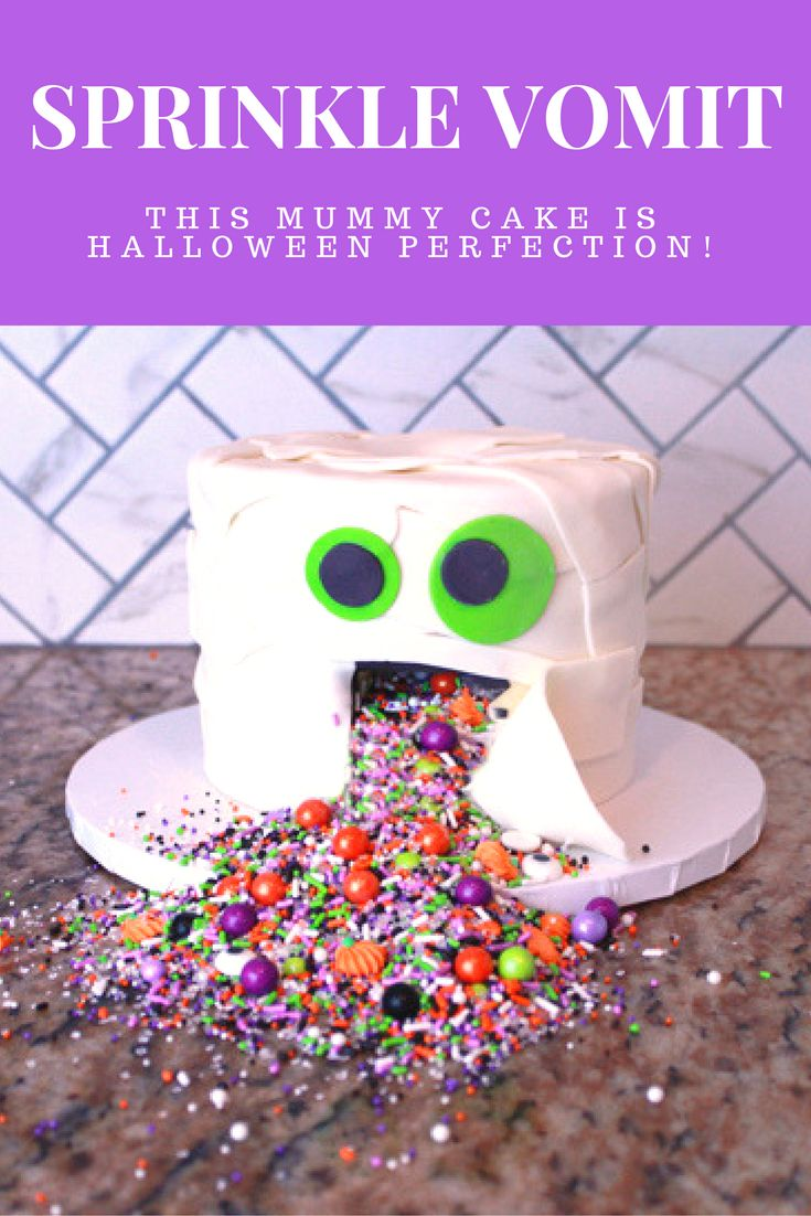 This Halloween mummy cake is a fun twist on a sprinkle pinata cake!