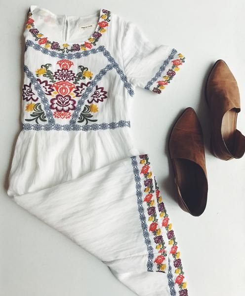 Beautiful white knee length dress with floral embroidery. Absolutely adorable on & has pockets!!! Note: We suggest that you size up if you are busty and want extra wiggle room in the arms. Length: 37.
