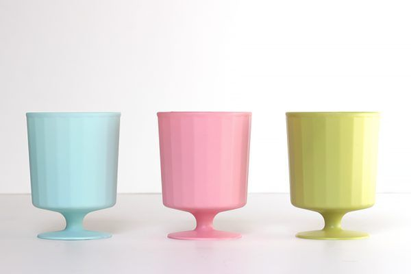 Spray paint trophies with unexpected colors in a matte finish.