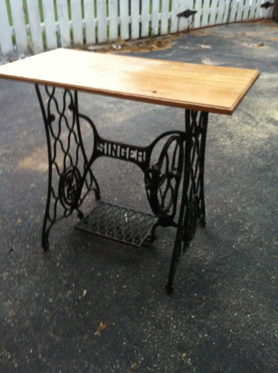 Oak Table on antique Singer sewing table base. $375.00, via Etsy.  This would be so cute if old sewing patterns were modged podged on it.  Would make a great sewing table.