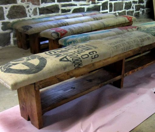 Reclaimed storage benches upholstered with old coffee sacks