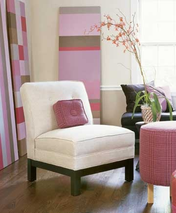 accent for emphasis       If you'd prefer to keep the wall and upholstery colors neutral, choose an accent color and layer it in the room. This homeowner's passion for pink shows up in cushions on the chair, the large painted panels of artwork, and the ottoman cover.  Used judiciously like this, even the brightest colors won't overwhelm quiet neutrals. One last piece of advice: In most situations, use the chosen color in accents around the room, like this, rather than concentrating it one…