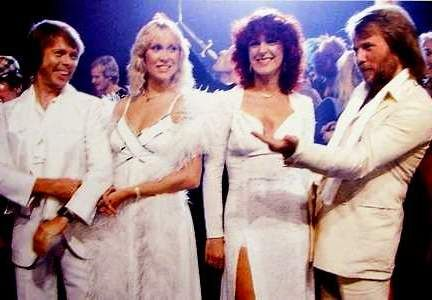 """When the """"Super Trouper"""" album was released in the UK on November 21st 1980 it had already broken a new record: over 1 million copies had already been sold in pre-sale. No wonder that the album reached the number 1 and stayed put for 9 weeks. Super Trouper was number 1 in other countries as well like Germany (2 weeks), Mexico (1), Holland (9), Switzerland (12), Zimbabwe (6) and Sweden (7). These pic show the ABBA members during the shoot for the cover of the abum, October 3th 1980."""