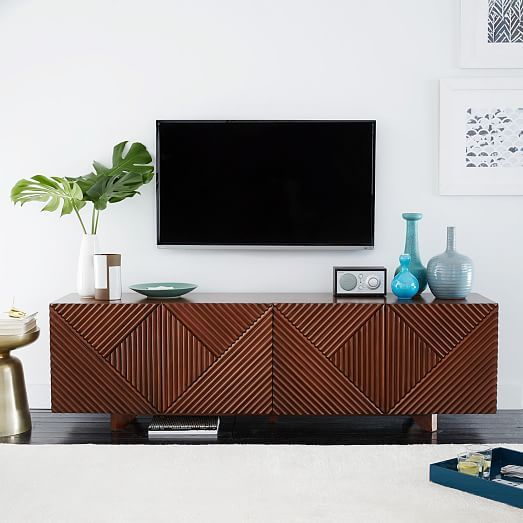 "Rosanna Ceravolo Media Console | west elm  Created in collaboration with Melbourne-based designer Rosanna Ceravolo, this media console's geometric patterned facade gives it texture and subtle depth. With a solid wood base and roomy cabinets, it's a storage piece and a work of art.   68.25""w x 16.4""d x 20""h. Engineered wood frame in an Espresso finish. Solid wood base. Made in Indonesia."