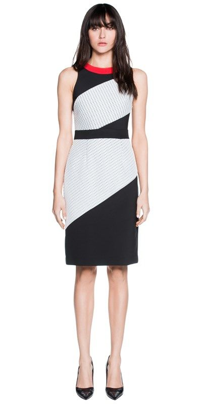 Made from bonded zigzag knit fabric, this fitted sleeveless dress features a slight racer neckline and spliced contrast panelling. Finished with a narrow contrast waistband and neckband. Fully lined, fastened with a metal zip back. Made in Australia.