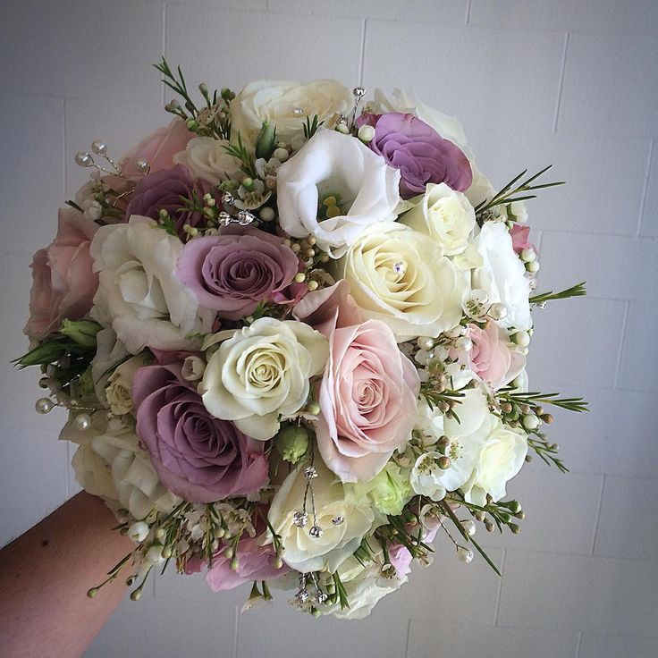 Louises beautiful bouquet of Sweet Avalanche Roses, Avalanche Roses, Faith Roses, Memory Lane Roses, Snowflake Spray Roses, Waxflower and White Eustoma.  Flowers by Charisma Florists  http://www.charismaflorists.co.uk/