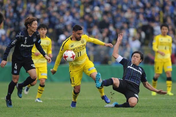 Diego Oliveira of Kashiwa Reysol is tackled by Yasuhito Endo of Gamba Osaka during the J.League J1 match between Kashiwa Reysol and Gamba Osaka at Hitachi Kashiwa Soccer Stadium on March 5, 2017 in Kashiwa, Chiba, Japan.