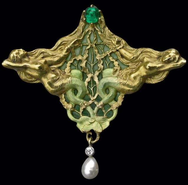 ART NOUVEAU - JOE DESCOMPS 1872-1948 (EMMANUEL-JULES-JOSEPH) 'The Melusines' Symbolist Pendant / Brooch Gold, Plique-à-jour, Enamel, Emerald & Pearl. Marks: Signed verso with monogram 'JD' for Joe Descomps. The brooch pin marked LG flanking a horn for Leon Gariod, French, c.1900. The Sirens two tails represent the unity of earth & water, body & soul. Beautifuly modelled with fine pique-à-jour enamel. Literature: cf. Art Nouveau Jewelry, Vivienne Becker, 1985, p. 217, pl. 85, 107, 115... <3