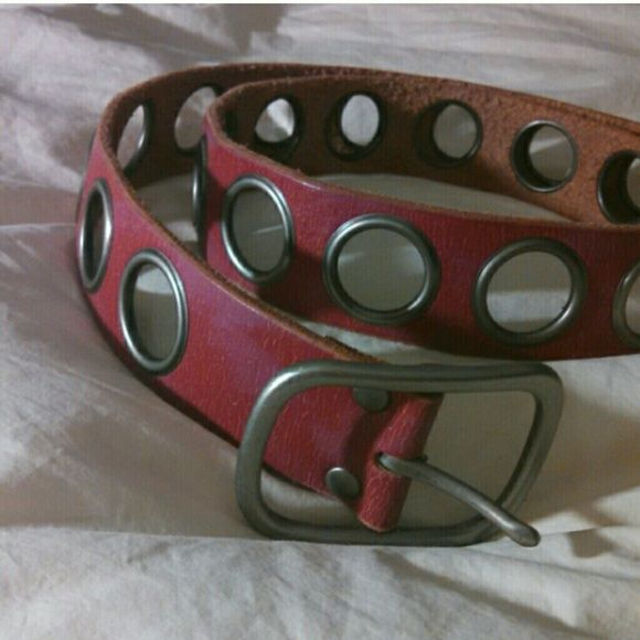 Pink Genuine Leather Fossil brand belt with rivets Excellent like new condition. Nice raspberry pink color with a brushed silver buckle. Fossil Accessories Belts
